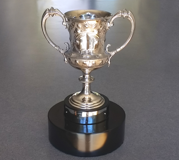 antique silverplate trophy restored, polished and base repainted