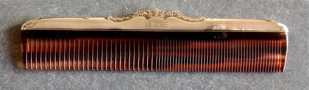 Sterling silver comb fitter with a new plastic tortiseshell comb