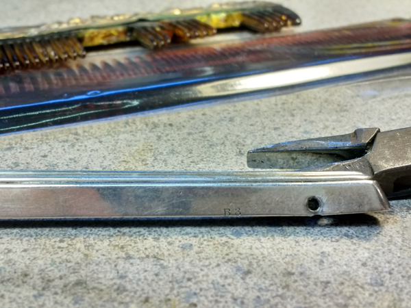 Damaged sterling silver comb fitter before repair