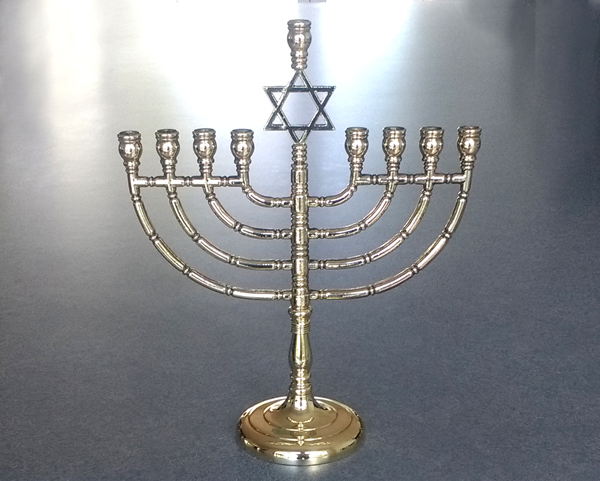 65 year old cast brass menorah repaired and polished