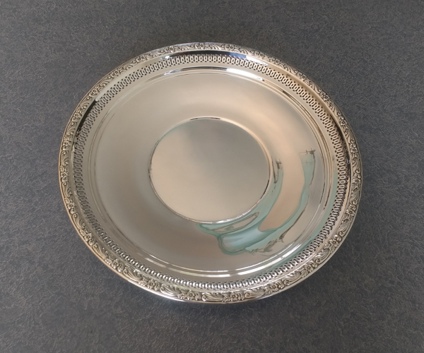 sterling silver plate with dents removed and polished