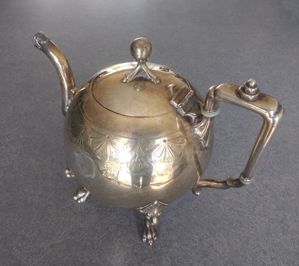 19th-century silver plate teapot with dent