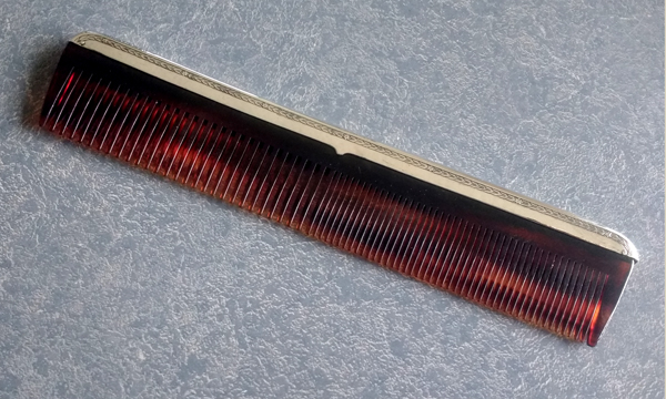 sterling silver men's comb with a new comb replacement