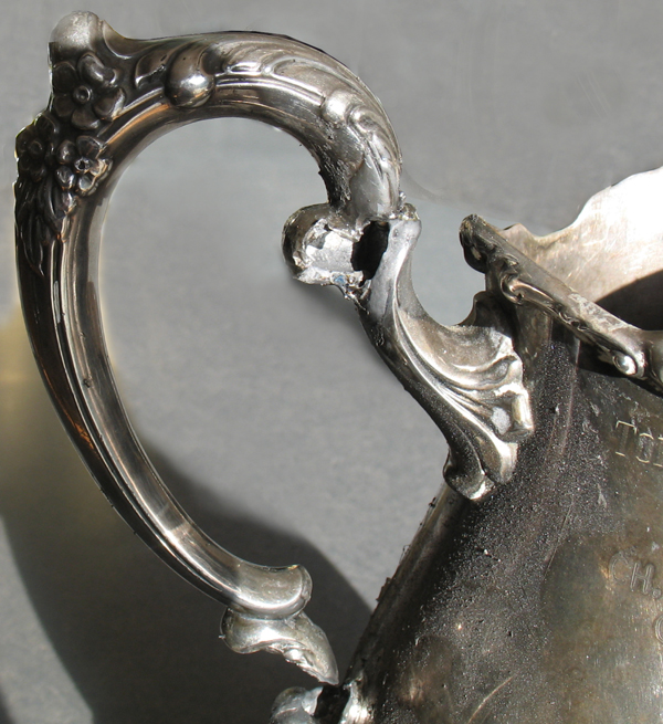 trophy handle melted by torch
