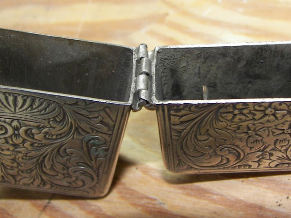 hinge broken on sterling silver cigarette lighter close-up