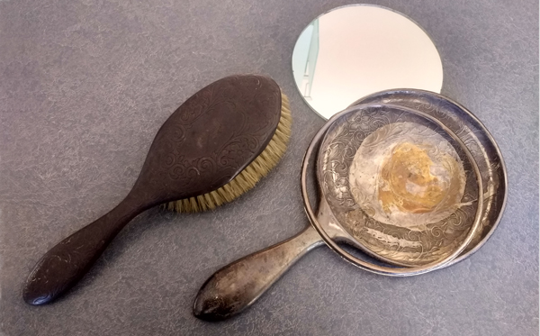 sterling silver brush and mirror tarnished and mirror doesn't fit