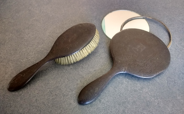 sterling silver brush and hand mirror dented and tarnished