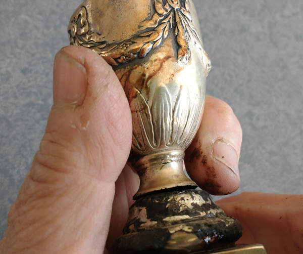 holding candle cup in place before repair