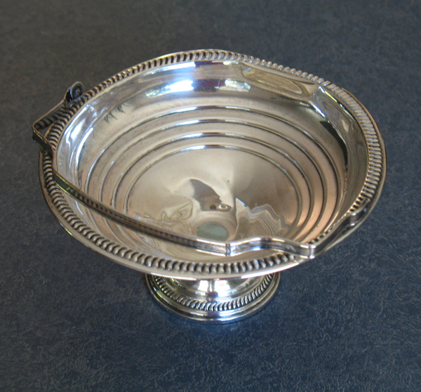 sterling silver candy dish with handle dented and misshapen