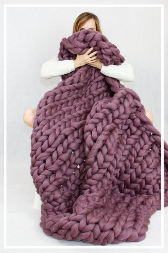 Giant Knit Blanket! - I've wanted one of these for ages! I love being wrapped up in warm blankets, with a hot chocolate in front of a fire (or the channel that shows a fireplace). This is definitely on my wish list!