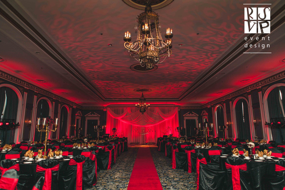Awarded Best Wedding Creative in Canada at the Canadian Event Industry Awards in Toronto, this Gothic wedding in the Adam Ballroom had a Dracula's Lair theme complete with flower arrangements from Blossoms Living. Moody lighting, golden candelabras and eerie skulls made for a chilling event.  Photo: Chelse Klette Photography