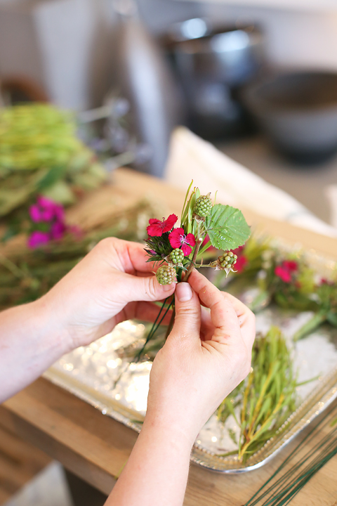 Bundle small flowers, leaves and berries together then wrap the bundle with florist tape and set aside. Continue making small bundles until you have enough to cover the entire crown.