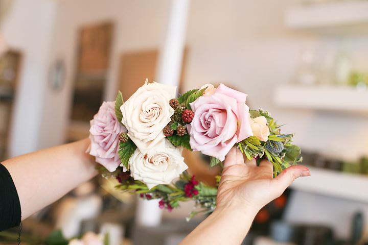 If you have large flowers to add, do so now. Push the flower stems into the bundles and affix with florist glue or tape. Jill mentioned that when working with large flowers, find balance by adding one at a time and taking a look from a variety of angles before adding another.