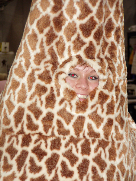 Testing out the face hole of a giraffe costume for a shoot.