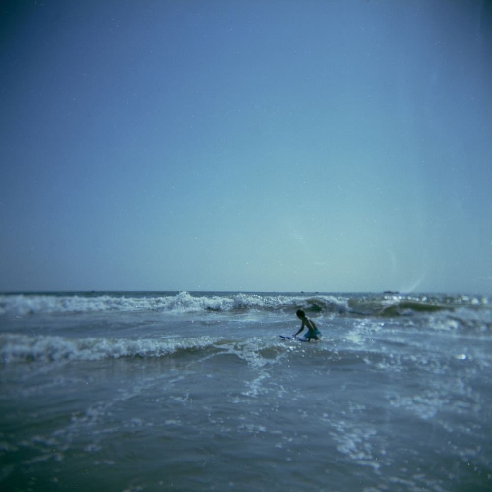 Xander surfing in Santa Monica.   August, 2012   Holga, Fuji Reala