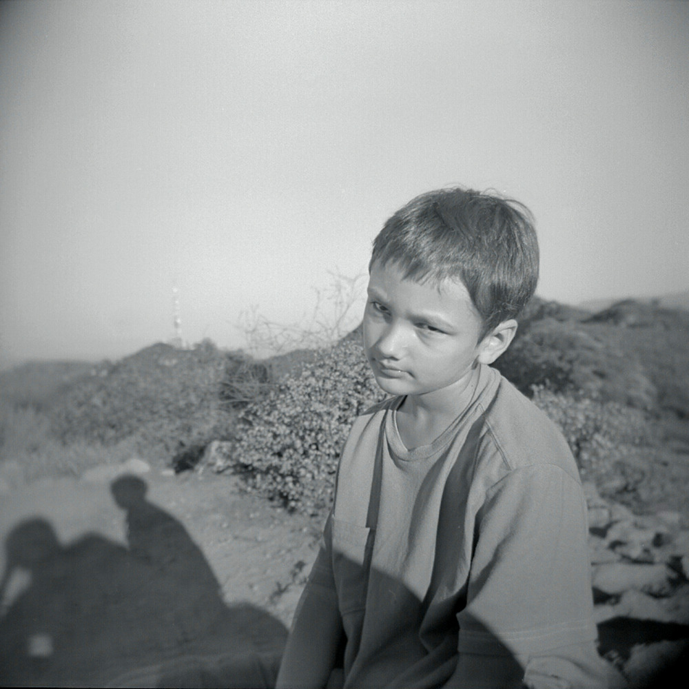 This is the face I'm dealing with lately whenever I want to take a photo……   Xander Brody, Burbank Peak, July 2012   Holga, Tri X 400