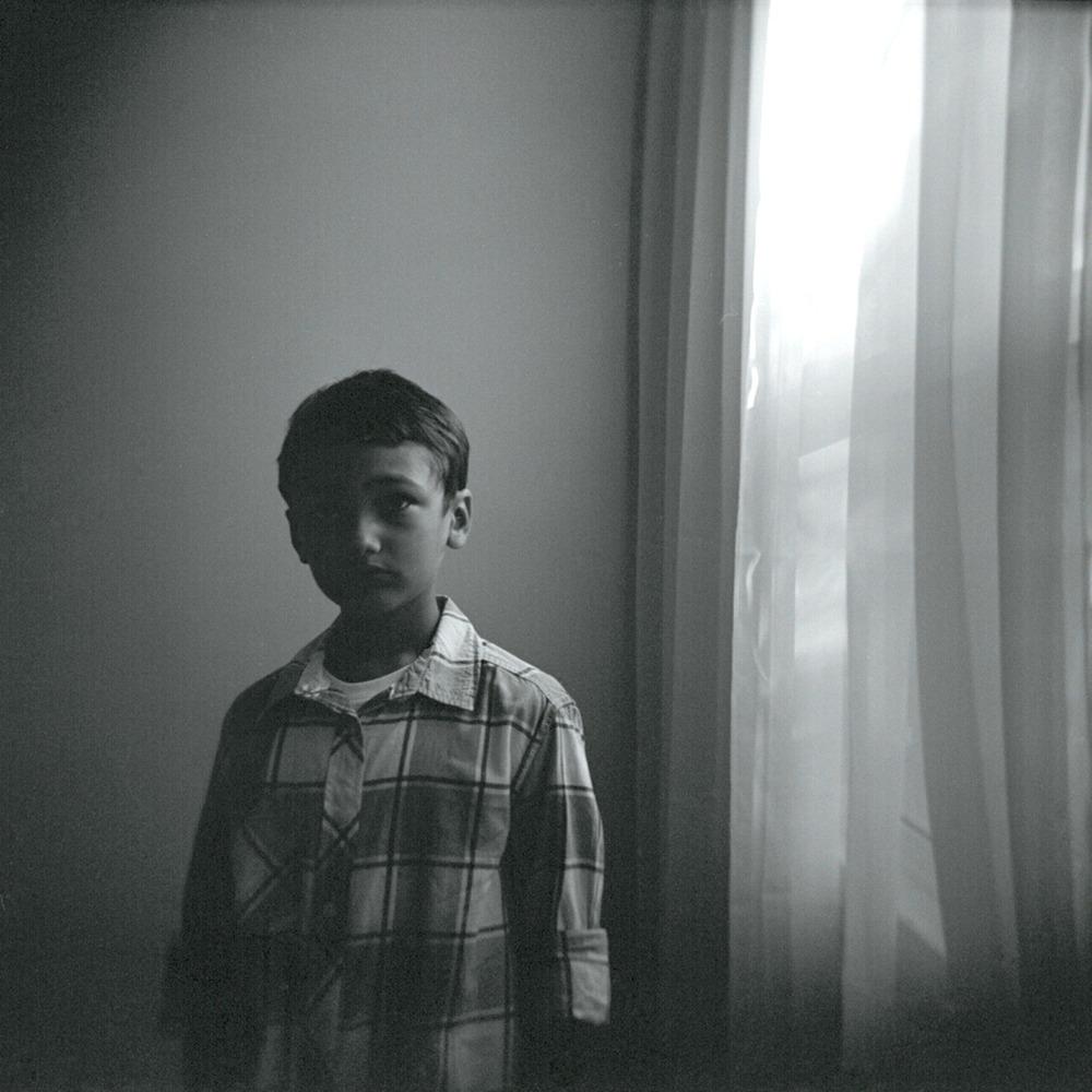 Xander by the window. July, 2012   Holga, Tri X 400