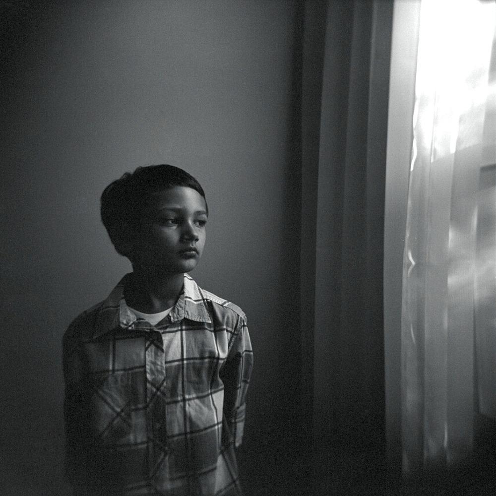 Xander Brody by the window, July 2012   Holga, Tri X 400