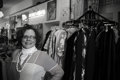 Ypsi Project: Linn Radtke  (by  ericarhiannon )   Linn grew up in Detroit, came to Ypsi to attend EMU and has stayed. She runs  Apple Annie's - specializing in vintage clothing, jewelry and ladies accessories. Linn has lived in Ypsi for 33 years and has had Apple Annies for that length of time also. She never expected the clothes she wore in the 70's to now be considered vintage :)  Jim MacDonald's Antiques shares the Cross street space with her but was at the Ann Arbor antique market, one of teh biggest antique shows in the midwest, when we had stopped in.