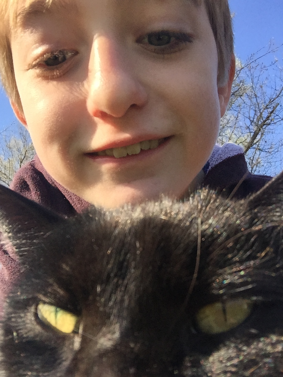 Dylan's selfie with a random barn cat - at quaker village in Danville, KY.