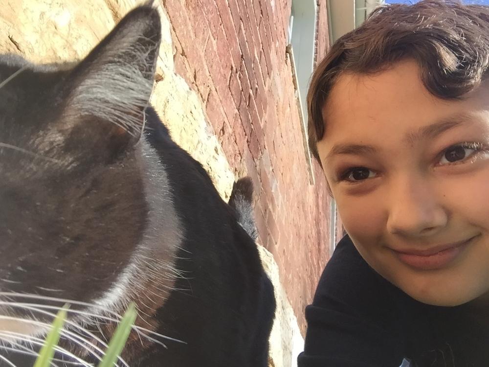 Xander's selfie with a random barn cat - at quaker village in Danville, KY.