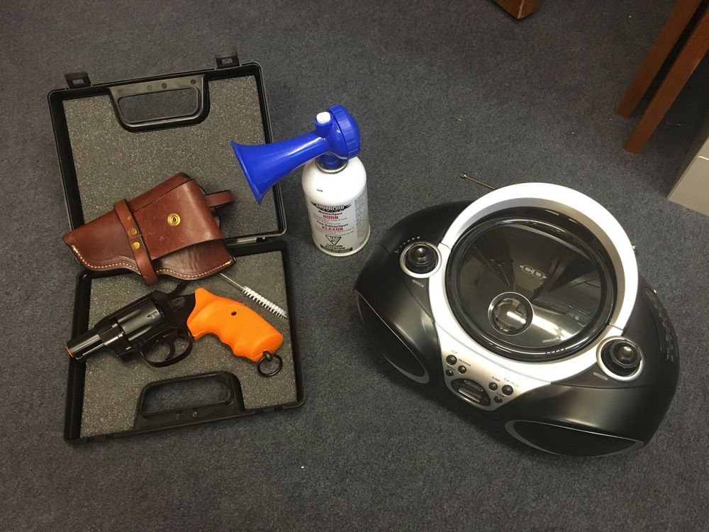 Airhorn, boombox, and starter pistol with case, brush, and holster. Photo: Avery Shawler