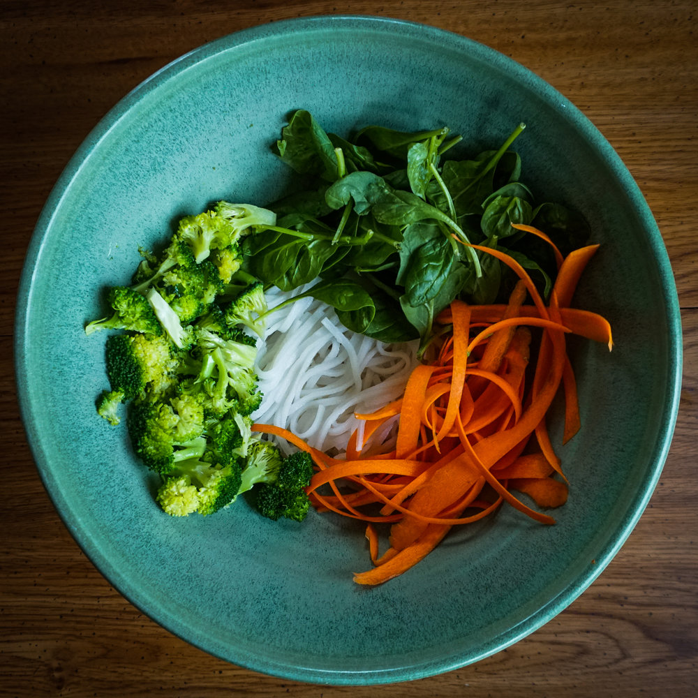 I then added the steamed broccoli to cooked rice noodles, raw spinach, and raw carrot peels.
