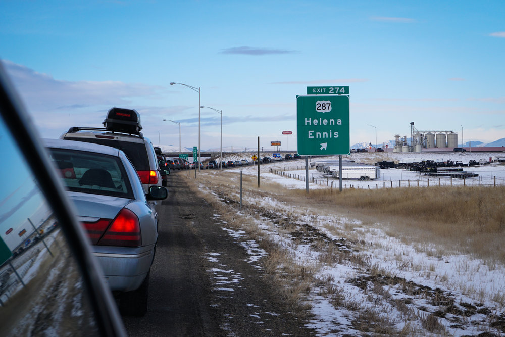 Cars line up along the interstate for the exit for Helena from I-90