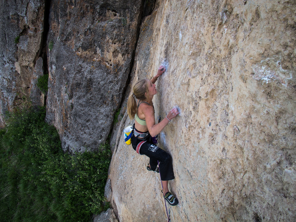 Inge climbing in Ten Sleep Canyon, WY. Photo by Scott Whitcomb