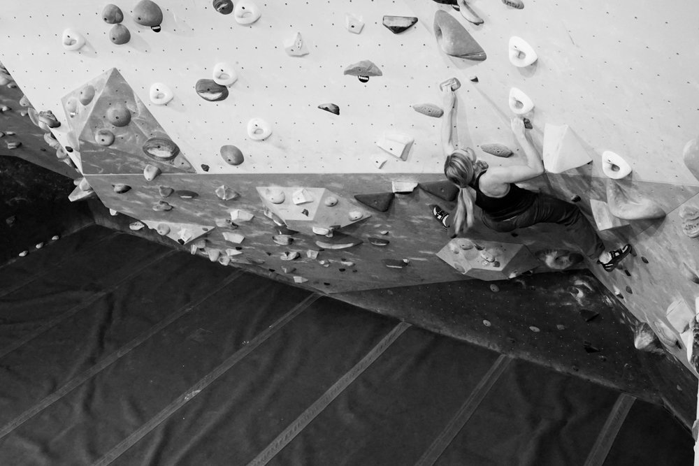 Mother climbing bouldering indoors strong