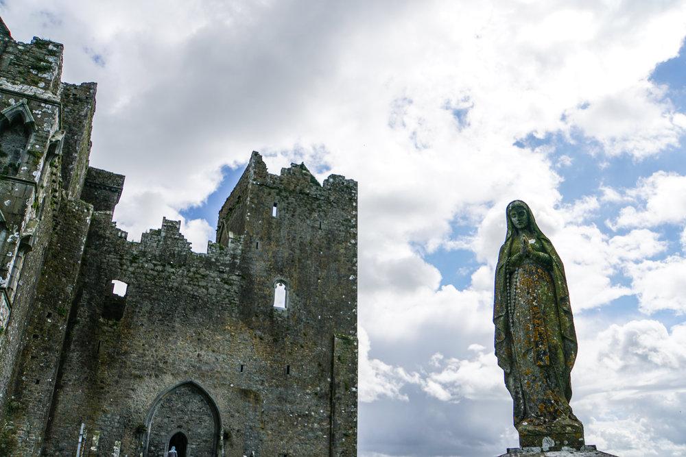 Rock of Cashel virgin mary with building.jpg