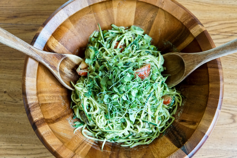 Zucchini noodles with pesto and healthy ingredients plants vegan