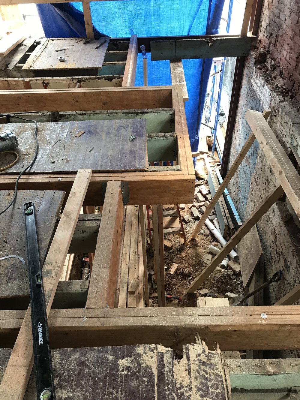 The new beams forming the opening for the new stairway