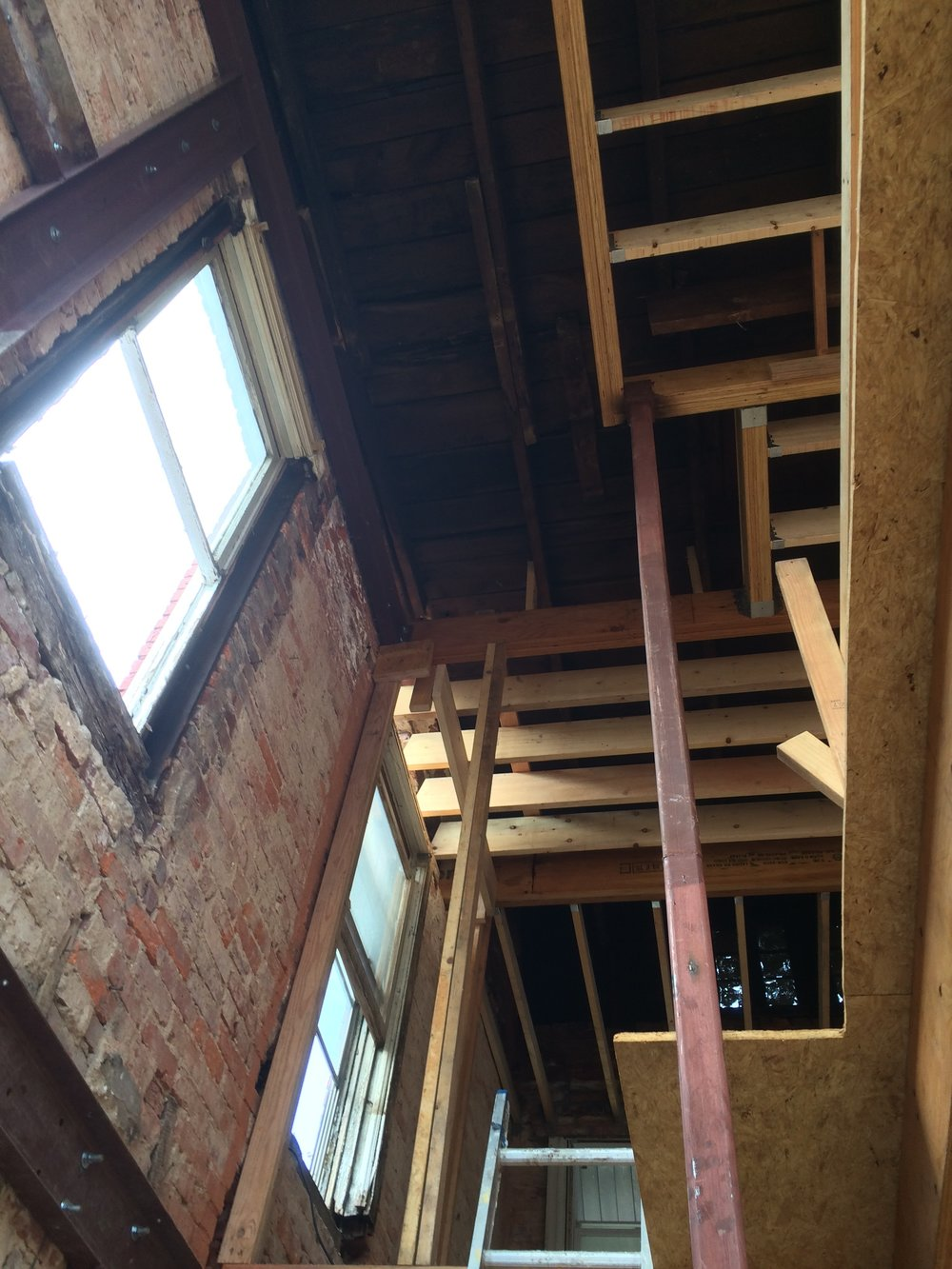 A view of the newly re-framed upper floors (looking up from the 1st floor)