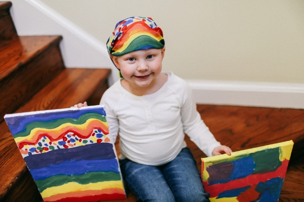 "Rosie's ""Forever Rainbow"" and ""Crazy Colors"" paintings that were the inspiration for our first head scarves."