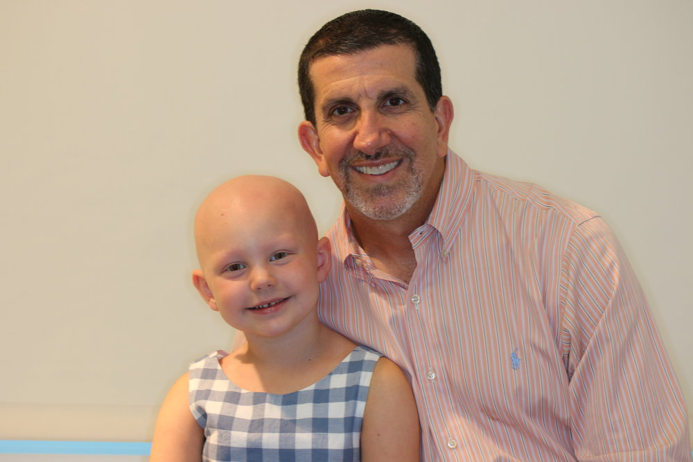 Rosie and Dr. Tony Mancini, Head of Pediatric Dermatology at Lurie Children's Hospital.  Rosie is thankful for his care, and wants to give back to Lurie.  She is also his biggest fan...