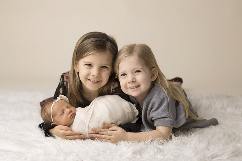Siblings with newborn