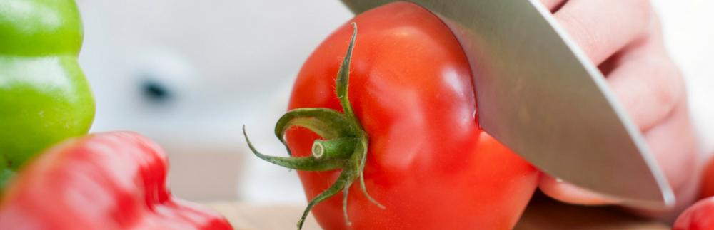 Sharp knife cuting tomato