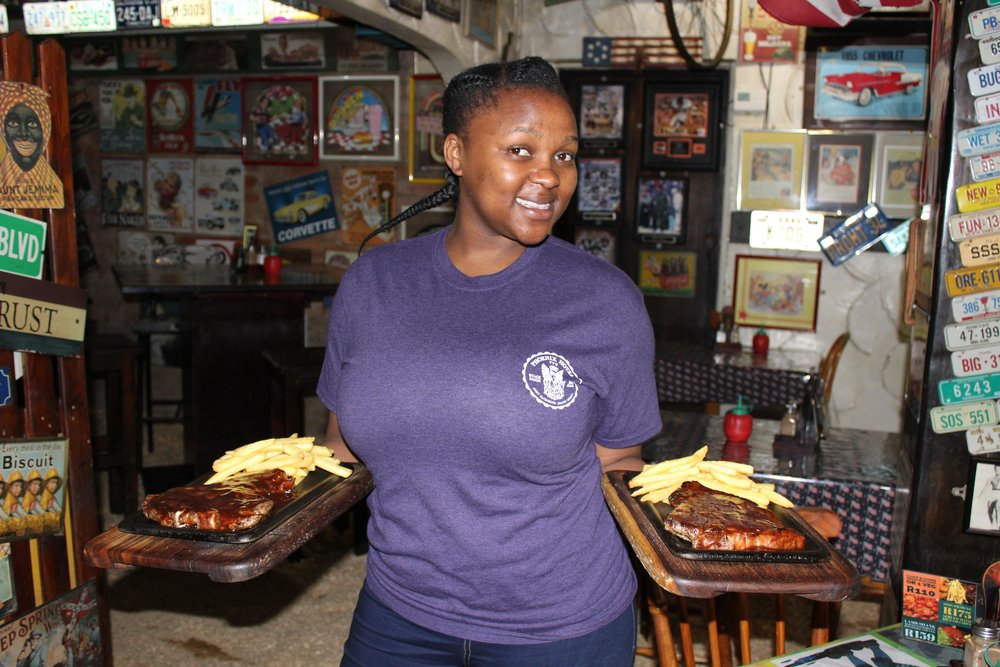University student Chwayita Mbambo waitresses in her spare time.JPG