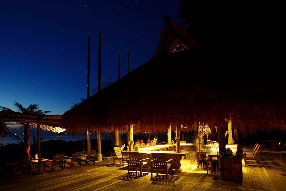 One of the restaurants by night
