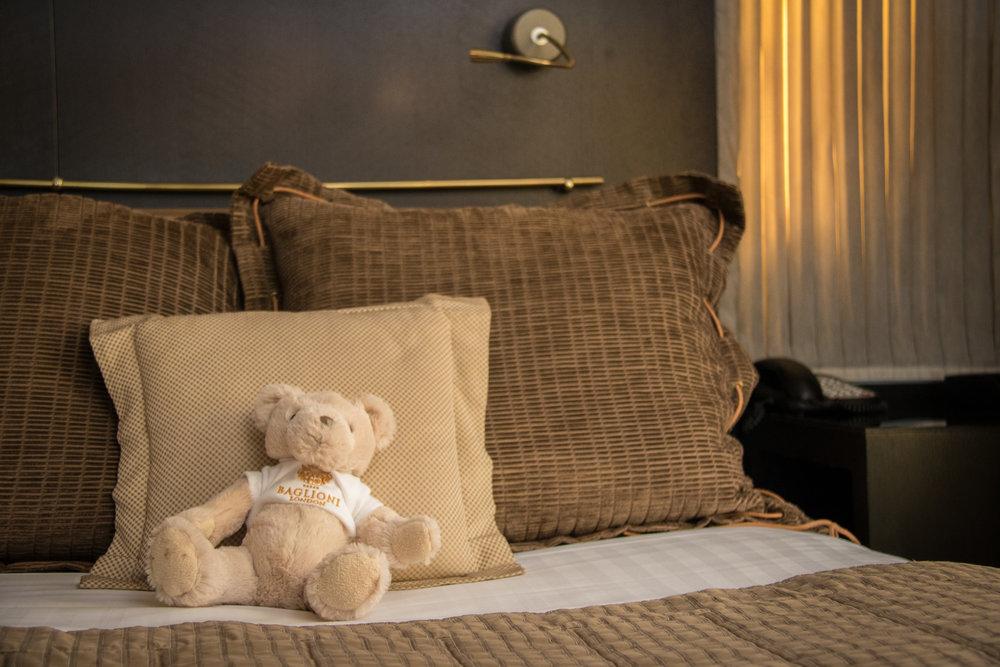 Bear at the restaurant, bear at the bar, bear at bed...
