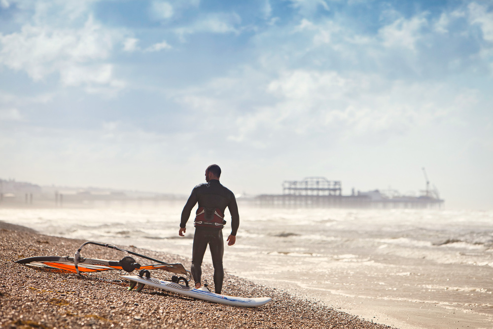 Windsurfer on the beach, Brighton & Hove, England