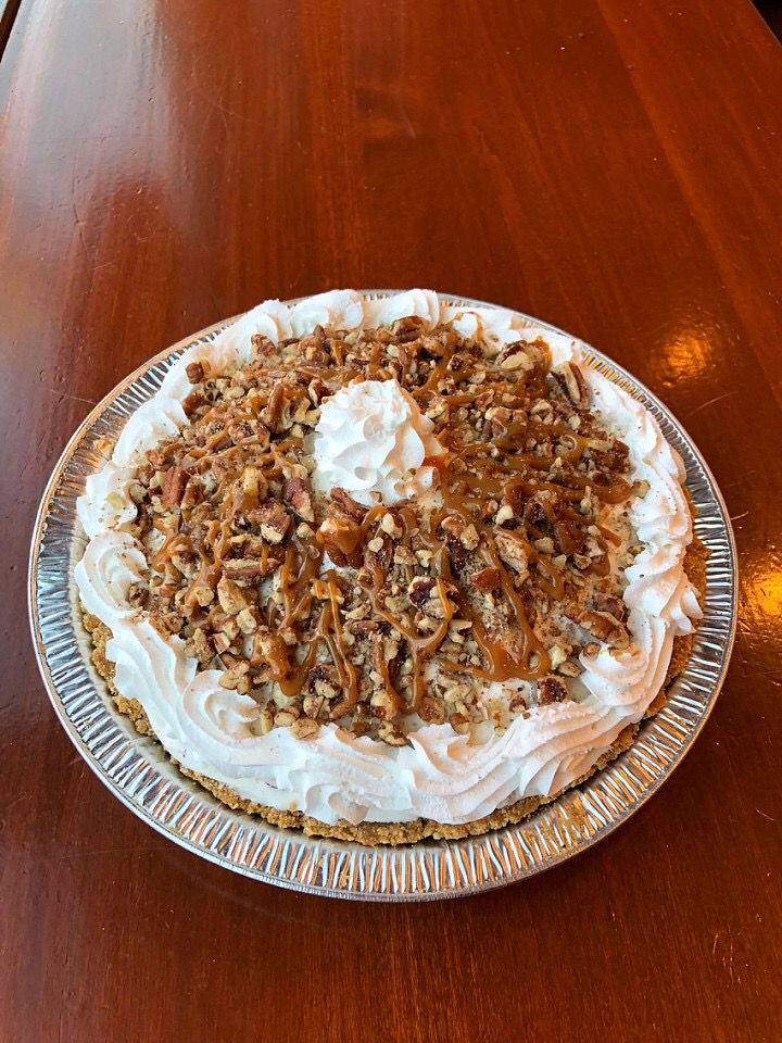 "ICE CREAM PIES - Our signature homemade crust with homemade ice cream, whipped cream and toppings that compliment flavor. (9"" Serves 8)"