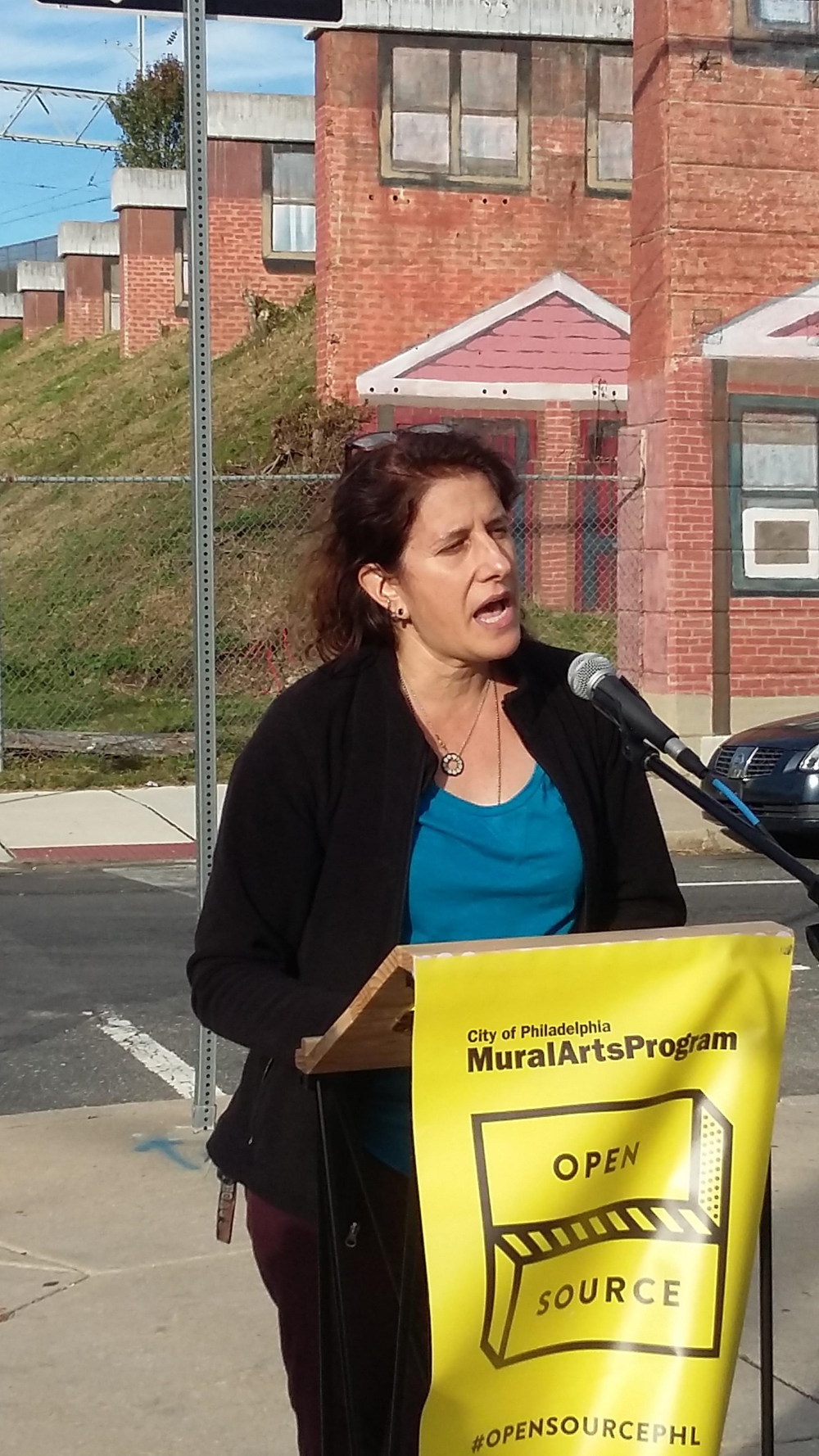 Naida  Burgos - Norris Homes Mural Dedication October 29, 2015 artist speaking.png