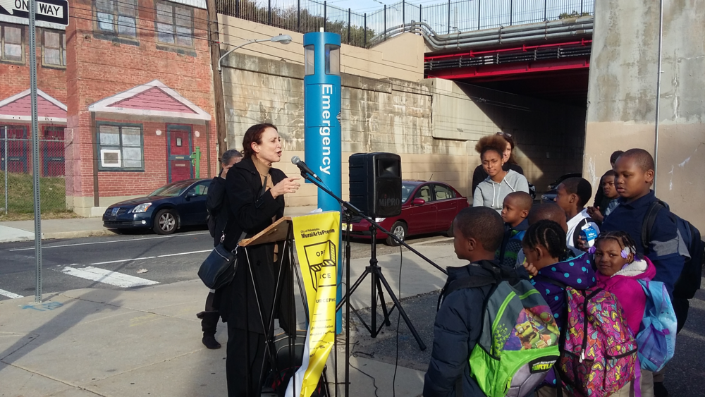 Naida  Burgos - Norris Homes Mural Dedication October 29, 2015 artist with kids.png