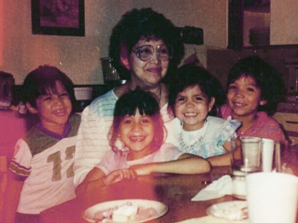 My brother Joseph, me, and cousins Lisa and Jaime with Grandma Mary.