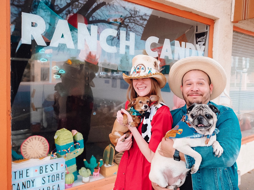 The new Ranch Candy owners Hannah Marshall and Stephen Treviño with their dogs, Lucy and Pickles.