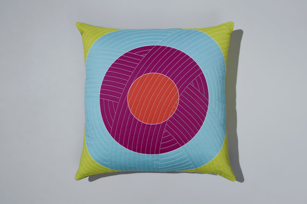 PostAndGleam_Pillows_OrangePinkBlueGreenCircle_COMP_Oa_FL2500.JPG