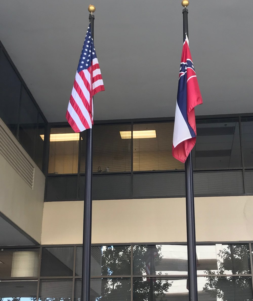 American flag and Mississippi state flag located in downtown Jackson, Mississippi