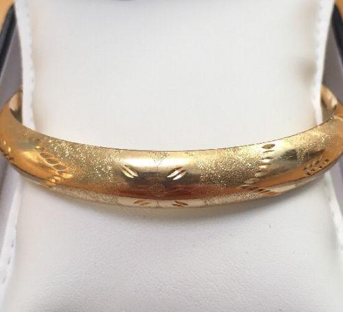 gold floral bangle.jpg